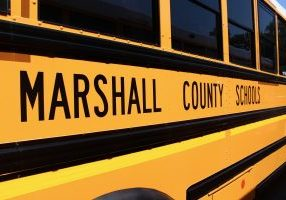 Side view of yellow Marshall County Schools bus